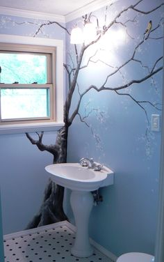 painted tree branches in a blue sky bathroom
