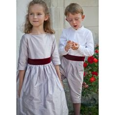 Check out our lovely length shorts for boys. Handmade in silk, taffeta or cotton, they will make a perfect wedding outfit for the kids. Page Boy Trousers, Boys Waistcoat, Boy Models, Rings For Girls, Gowns With Sleeves, Traditional Weddings, Boy Outfits, Fashion Dresses, Bridesmaid Dresses