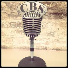An old school microphone on the memorabilia wall on set in Studio 57 (from our friends at CBS This Morning) Old School Microphone, Vintage Microphone, Studio 57, Radio Advertising, Guitar Art, On Set, Friends, Wall, Body Art