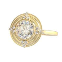 Erika Winters Thea Halo ring with diamonds and a European-cut centre stone - diamond sold separately ($4,400).