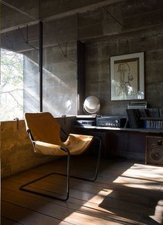 Paulistano Armchair,1957. Design : Paulo Mendes da Rocha. Eclipse Lamp, 1982. Design : Mauricio Klabin – Brazil. via roselandgreene. photo by ruy teixeira