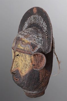"View 2 of an ancestral yam mask from Abelmam people, Sepik River Region, Papua New Guinea. Height 14"", Width 10"". ""This piece has been tightly woven into a full form, an original style as yam masks are more often constructed in a two dimensional shape."""