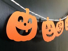 String cute pumpkin faces together to make easy Halloween garland Halloween Decorations For Kids, Halloween Garland, Halloween Kids, Halloween Pumpkins, Cute Pumpkin Faces, Bumper Stickers, Handmade Items, Activities, School