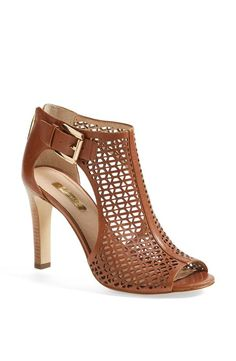 Caged peep-toe sandal.