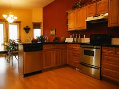 Light Orange Kitchen Walls mediterranean, orange walls the color of the accent wall is