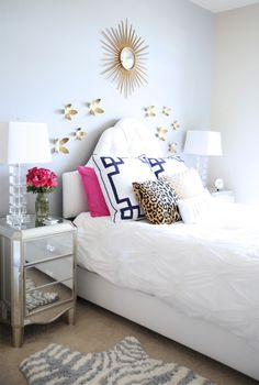 Light and airy white navy and pink bedroom