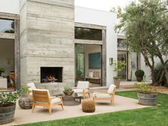 outdoor seating area with fireplaceseating nook with neutral tones and lots of wood | c magazine via coco kelley