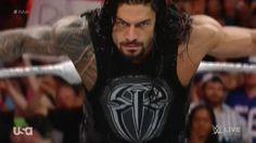 Roman getting ready to spear Bo Dallas
