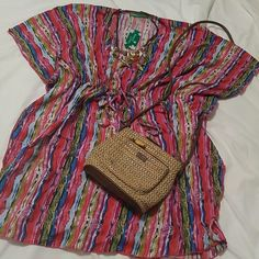 NWT beachy dress Great for a seaside dress or beach coverup.  Transitions to the city with a pair of leggings.  Sizing is very flexible, but best for an L to XL.  The tie is just a little high for me, should be just under the bust and I have a large bust that makes fitting tricky.  Anyone under a G cup should be great. hawaiian clothing Dresses Mini