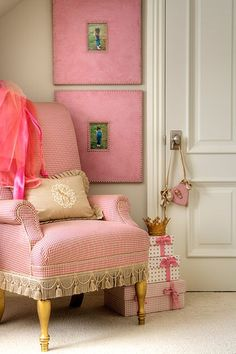 great pink framed pictures and chair, tucked in a little spot in this room. Love!