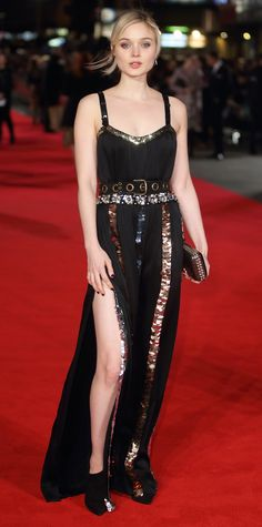 Bella Heathcote shimmered at the Pride and Prejudice and Zombies premiere in a black belted Lanvin gown treated to strips of oversize sequins in blue, gold, and silver. She accessorized with an embellished clutch and black Casadei booties.