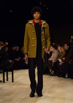 Felted wool duffle coat with traditional toggle fastenings, worn over a knitted merino wool polo shirt