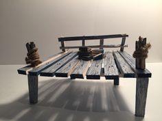 A miniature I made of a dock I designed for a summer window for Michael Aram