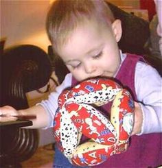 You'll find free directions and a pattern to sew a fabric baby toy ball that small hands can grab and hold. This ball is created with sections that are designed for a baby's hand.