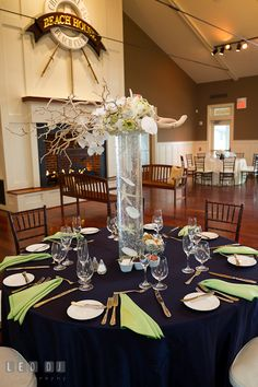 Table setup with tall centerpiece at the Beach House ballroom. Chesapeake Bay Beach Club wedding bridal testing photos by photographers of Leo Dj Photography. http://leodjphoto.com