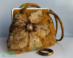 Bag is made wet felting method. Drawing is made in the technique of watercolor wool. For the decoration used wool, viscose fiber and silk fabric,