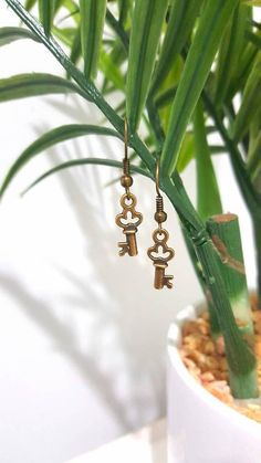 Check out this item in my Etsy shop https://www.etsy.com/au/listing/533116452/antique-gold-tiny-key-earrings