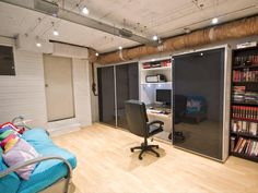 Home Office in the basement. For small on space. Build a closet with large sliding doors. I would choose a lighter color for the doors.