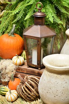Wheat, pumpkins, and gourds create a beautiful fall arrangement. Bevolo Rault Pool House Lantern. #lanterns #fall #decor #decorating #decoratingideas #bevolo