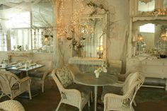 This room seems very English to me . Delicate and pastel