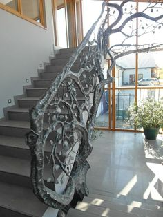 Forged tree, leaf and vine staircase rail