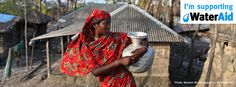 A woman in Bangladesh holding a water container