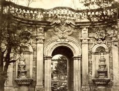 A view of the Fountain Gate in Yuan Ming Yuan, or the Garden of Perfect Brightness. Beginning in 1709, the Qing emperor Kangxi began the construction of this garden retreat, which was modeled on the grand palaces, gardens, and fountains of Europe. Much of Yuan Ming Yuan was destroyed in the Second Opium War.