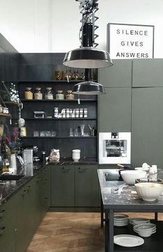 Kind of industrial loft kitchen with dark cabinets in Amsterdam