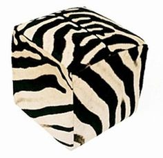 zebra print pouffe-  see our own cushion versions soon in a variety of fantastic printed hides