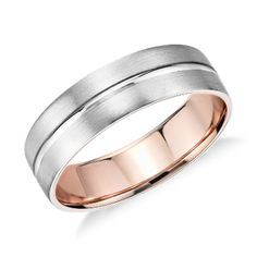 Solidify your love with this platinum and 18k rose gold wedding ring, showcasing a two-tone interior accent and a brushed finish.