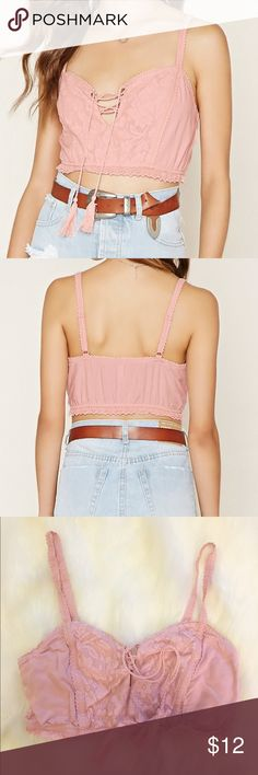 Forever 21 Crop Top NWOT Forever 21 pink crop top with tassels. Never worn! Too small on me Forever 21 Tops Crop Tops