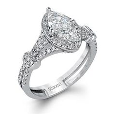 Shop online SIMON G TR602 Halo 18K - White Gold Diamond Engagement Ring at Arthur's Jewelers. Free Shipping