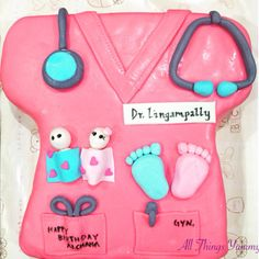 Themed Cakes - Gyneacologist Themed Cake   All Things Yummy   From the little ones to those who bring them in our lives.. A doctor cake for a gynaecologist :) #doctorthemecake #doctorcake #cake #customisedcake #doctor #scrubs #pinkscrubs #gynaecologist #fondant #fondantcake #babyfeet #babygirl #babyboy #baby #scissors #pen #stethoscope #doctorstuff #atyummy #dessertgram #cakeartist #cakedecorator #instacake #cakedecorating