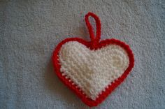 White crochet heart ornament with red trim by CreativeCrochetbyChris, $5.00 USD  SOLD