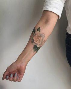 Forearm colored rose tattoo by amandawachob