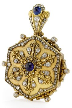 Eduard Wilhelm Schramm - An Antique Gold and Jewelled Pendant Locket, St. Petersburg, Circa 1890. Of hexagonal form, the six panels set with diamonds and sapphires, the suspension ring also set with diamonds and sapphires, the six panels opening to reveal a glazed circular aperture. Length 5.1cm. #EduardWilhelmSchramm #antique #locket #pendant