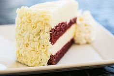 Layers of moist red velvet cake and our original cheesecake! We're drooling! - Ultimate Red Velvet Cheesecake
