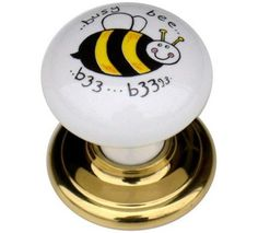 2 x Busy bee 37mm white solid ceramic porcelain and polished brass effect cupboard cabinet knobs. Swish http://www.amazon.co.uk/dp/B006RG2OIC/ref=cm_sw_r_pi_dp_PNvrvb0YKCA4J