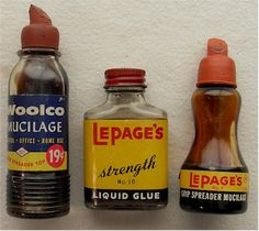 LePage's Glue with rubber top - the bottle on the far right was a staple on our school supply list every September