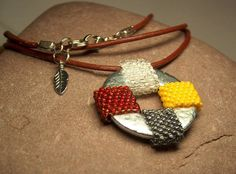 Beadwork pendant necklace in Native American medicine wheel colors beaded on a stainless steel washer