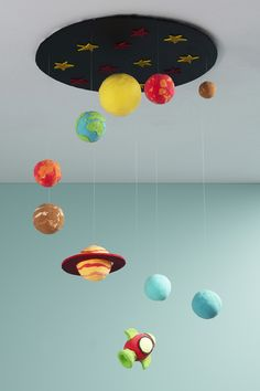 Make your own galaxy. Cover styrofoam balls with modeling clay and hang them from a starry sky made from cardboard. Creation Preschool Craft, Craft Activities For Kids, Preschool Crafts, Fun Crafts, Solar System Projects For Kids, Solar System Crafts, Space Crafts For Kids, Diy For Kids, Planet Crafts