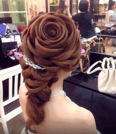 Crazy hair design done to look like a rose / flower. Super intricate and looks like it took forever to do.