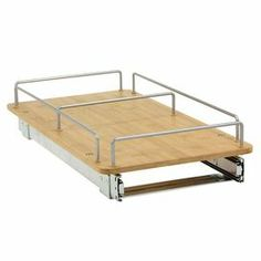 """Sliding under-the-cabinet organizer with metal framing and a bamboo shelf.   Product: Under-the-cabinet organizerConstruction Material: Bamboo and metalColor: NaturalFeatures: One shelfDimensions: 4.3"""" H x 14.5"""" W x 21"""" D"""