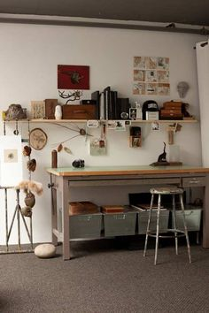 drafting table + borco made fashionable. it's actually cute here. it's also because it's a slimmer style, not huge and bulky like ours at school. and i love the storage underneath - clever!