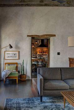 Rustic living room and kitchen of Diane Keaton's Arizona house. #rustic #adobe #livingroom