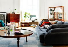 round coffee table + large blue couch