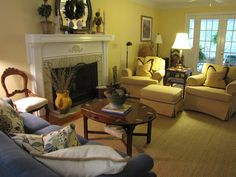 Excellent seating arrangement for a long living room with a centrally located fireplace.