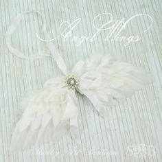Wintry White Angel Wing Ornament   AllFreeChristmasCrafts.com