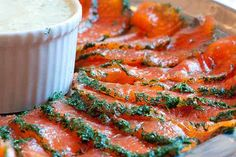"Gravlax - The recipe is remarkably simple, and since then, I have made this dish many times. You just need a nice raw skin-on salmon fillet and a plastic container, ideally with a lock-on lid. After curing for a few days, it is best served with a special ""mustard-dill sauce for gravlax"" and bread. Gravlax makes a wonderful starter but (with enough bread) it can also provide a full meal."