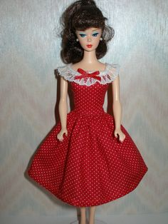 Barbie dress is handmade with a red and white polka dot trimmed with white lace and red ribbon. Dress only--doll is not included. Made in a